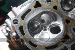 请问如果比亚迪f6发动机正时皮带断了,缸盖的气门会弯吗?